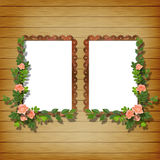 Two frameworks for photo. On the wooden background with flowers Royalty Free Stock Photos