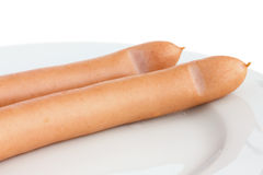 Two frankfurter sausages on a plate Stock Image