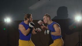 Two free fighters boxing in the gym. Slowly.  stock video