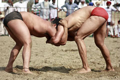 Two free hand wrestlers in action during a match in rural India Stock Image