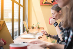 Two freelance working in coffee shop, Nomad worker conceptual, c. Ouple work together in cafe with laptop stock image