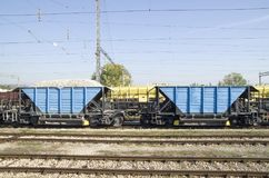 Two freight wagons with gravel on the siding. On station Royalty Free Stock Image