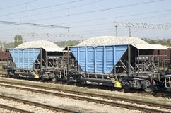 Two freight wagons with gravel on the siding. On station Stock Photography