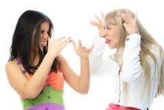 Two freinds quarrel and make faces royalty free stock photo