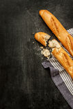 Two french baguettes on black chalkboard from above Royalty Free Stock Photos