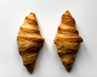 Two french croissants on white background. From above Royalty Free Stock Image