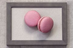 Free Two Fresch Macaroons Of Pink Colors In Wooden Frame, Abstract Sweet Art Stock Photography - 118730092