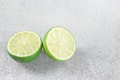 Two ripe slices of green lime citrus fruit stock images