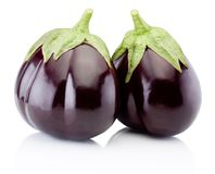 Two fresh aubergine isolated on white background. Two fresh aubergine isolated on a white background stock photo