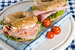 Two fresh bagels with honey roasted ham Royalty Free Stock Photos