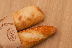 Ciabatta and French loaf in a paper bag stock photo