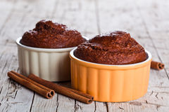 Two fresh baked browny cakes and cinnamon sticks Stock Photography