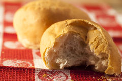 Two fresh baked German rolls. Broken Stock Photography