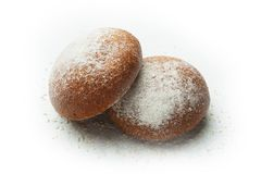 Two fresh black bread rolls with sesame seeds isolated on a bamboo background royalty free stock photo