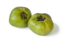 Two fresh black sapote fruit Royalty Free Stock Images