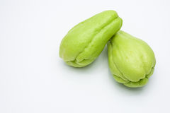 Two fresh Chayote fruits isolated on white. Two fresh Chayote fruits isolated on white background Royalty Free Stock Image