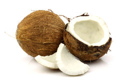 Two fresh coconuts and one opened. On a white background Royalty Free Stock Images