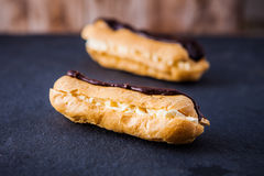 Two fresh cream chocolate eclairs Stock Photo