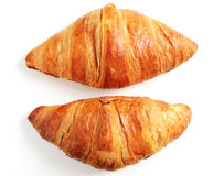 Two fresh croissant on a white Stock Photos