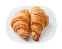 Two fresh croissant on a white plate.  royalty free stock photos