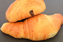 Two fresh croissants. On a black background Royalty Free Stock Photography