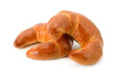 Two fresh croissants isolated on white background. Stock Image