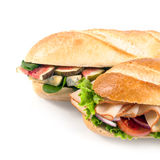 Two fresh crusty baguettes with savory filling Royalty Free Stock Photography