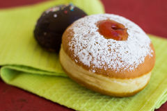 Two fresh donuts on a napkin. Two fresh donuts (sufgniyot) on a napkin Stock Images