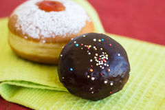 Two fresh donuts on a napkin. Two fresh donuts (sufgniyot) on a napkin Royalty Free Stock Images