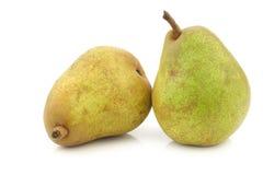 Two fresh doyenne de comice pears Stock Photo