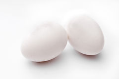 Two fresh eggs. On light background Stock Photography