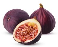 Two fresh figs fruit one cut in half. Isolated on white background. Clipping Path. Full depth of field Royalty Free Stock Images