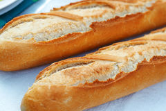 Two fresh French baguettes close up Stock Photos