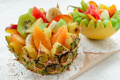 Two fresh fruit salad in handmade melon and pineapple bowl. Stock Image