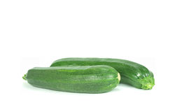 Two fresh courgettes. Two fresh and green courgettes on white background Royalty Free Stock Image