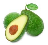 Two fresh green ripe avocado and slice Stock Photos