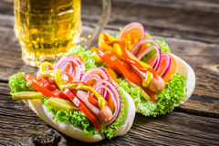 Two fresh homemade hot dog with beer Stock Photo