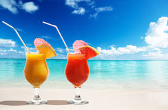 Two fresh juices on beach Royalty Free Stock Photography