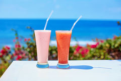 Two fresh juices or smoothies on a tropical resort Royalty Free Stock Image
