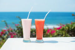 Two fresh juices on a tropical resort Royalty Free Stock Images