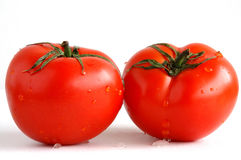 Two fresh and juicy tomatoes Stock Photos