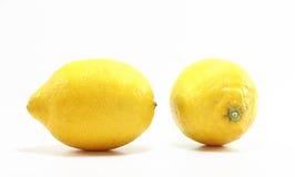 Two fresh lemons. Isolated on white background royalty free stock photos