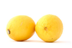 Two fresh lemons on white Royalty Free Stock Photo