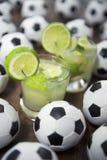 Two Fresh Lime Caipirinhas Brazilian Soccer Balls Stock Photography