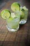 Two Fresh Lime Caipirinhas Wood Table Stock Photography
