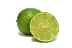 Two fresh limes on a white background Stock Photo