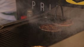 Two Fresh meat cutlets in a frying pan grill. For burger stock footage