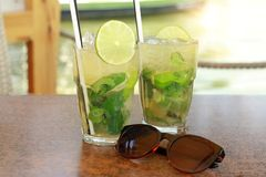 Two fresh mojito cocktails on the table Royalty Free Stock Photos