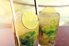 Two fresh mojito cocktails on wooden table Stock Image