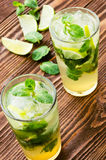 Two fresh mojitos cocktail. Mojitos with mint leaves, lime and i Royalty Free Stock Image